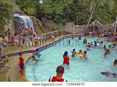Families Swimming At A Resort
