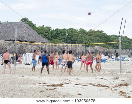 VARADERO,CUBA - OCTOBER 3, 2015 : Young tourists playing voleyball at the beach