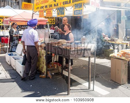 NEW YORK,USA - AUGUST 15,2015 : Ethnic food for sale at a street stand in downtown Manhattan