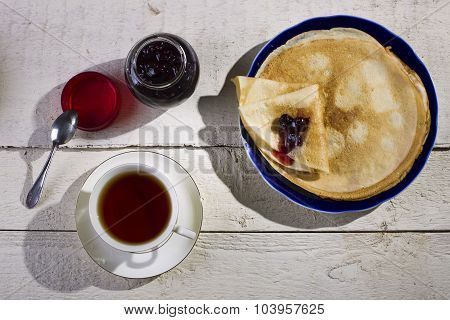 Pancakes With Jam On A Wooden Background.