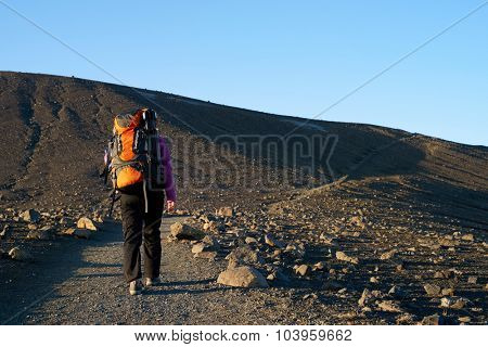 Young asian woman hiking in Iceland with backpack and outdoor gear on vacation holiday travel adventure