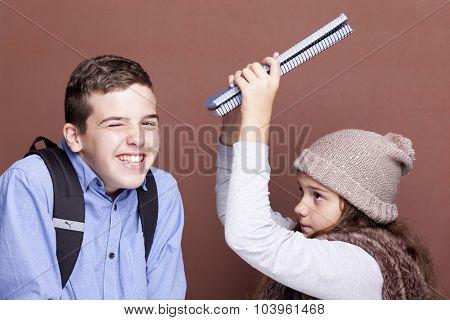 School kids having fun on brown background