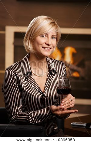 Young Businesswoman Holding Glass Of Wine