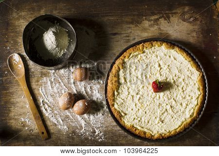 Cheesecake On A Wooden Background.