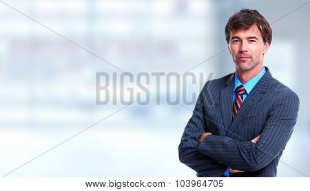 Executive businessman over blue office background.