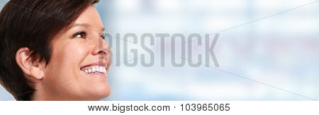 Beautiful mature smiling lady face over blue banner background.