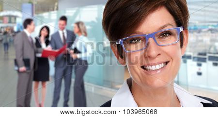 Face of mature business woman with eyeglasses. Close-up.