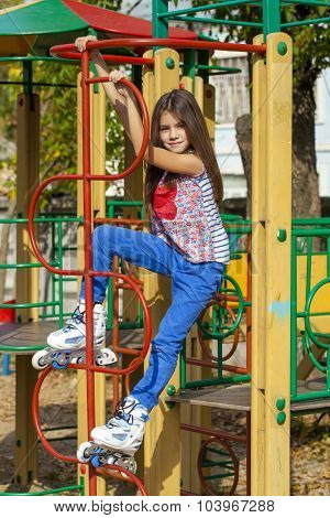 Portrait of a ten-year girl on a playground in roller skates