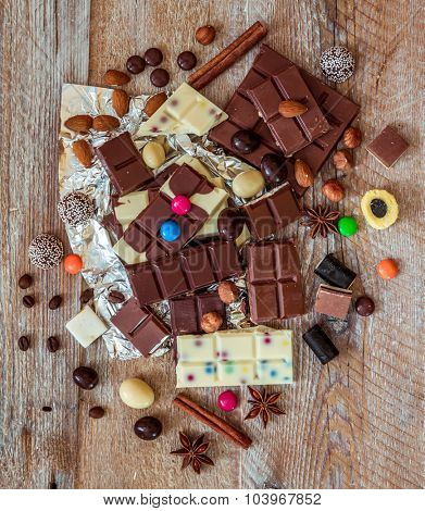 chocolate and candies on a wooden background