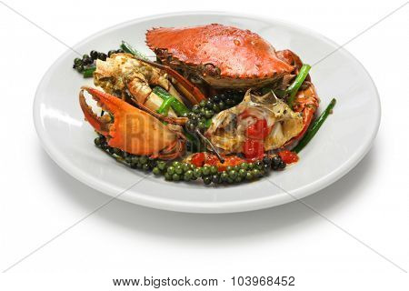 stir-fried crab with green kampot pepper, cambodian cuisine isolated on white background