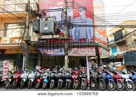 BANGKOK, THAILAND, JANUARY 15, 2015 : A motorbike store with a row of vehicle standing in the street of the Chinatown district in Bangkok, Thailand