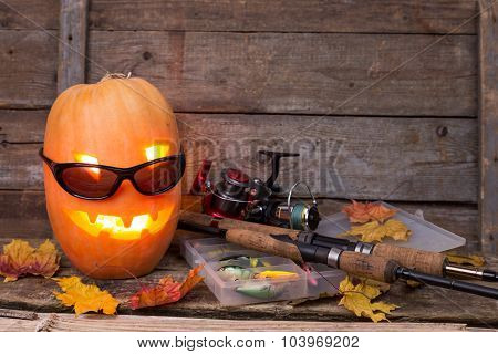Halloween Pumpkin In Eyeglass With Fishing Tackles