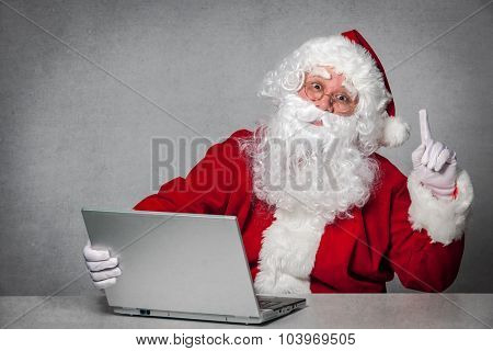 Santa Claus working with the laptop computer