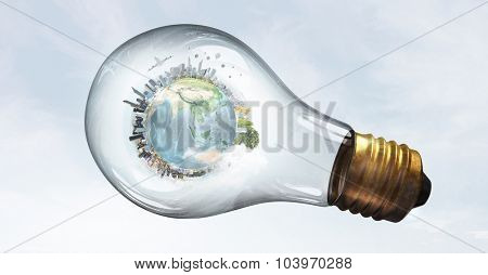Planet Earth inside of light bulb. Elements of this image are furnished by NASA