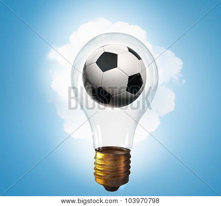 Glass lightbulb with football inside on blue background