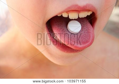 white pill on tongue child