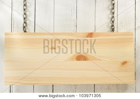 hanging signboard board on wooden background