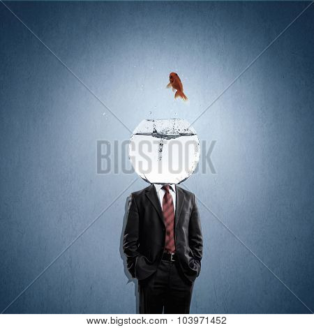 Man with water bowl with fish instead of head