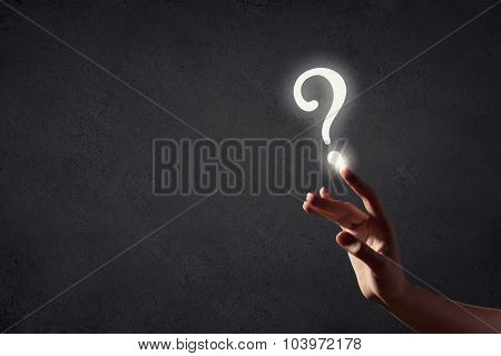 Person hand touching with finger question sign