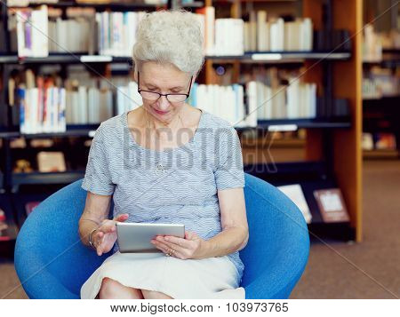 Elderly lady working with tablet