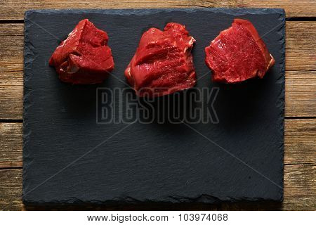 Raw beef filet mignon meat over slate
