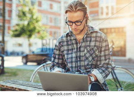 Concentrated Young Man With His Laptop