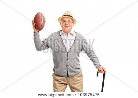 Happy senior gentleman with a black cane holding a football and looking at the camera isolated on white background