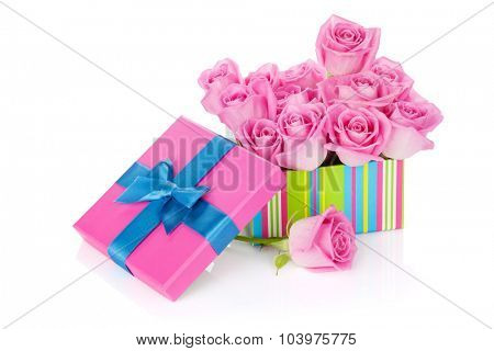 Gift box full of pink roses. Isolated on white background