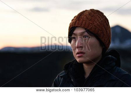 Cute chinese asian girl portrait in beanie in winter cold vacation