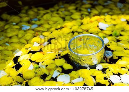 Water Mixed With Perfume And Vivid Flowers Corolla , For Songkran Festival In Thailand.