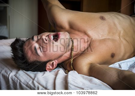 Young Sleepy Man, Lying in Bed Yawning