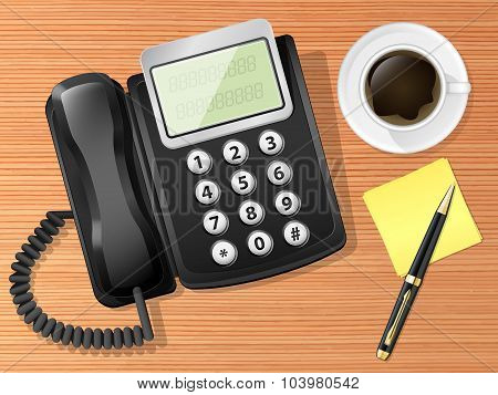 Office Phone On The Desk With Coffee Cup And Pen. Top View