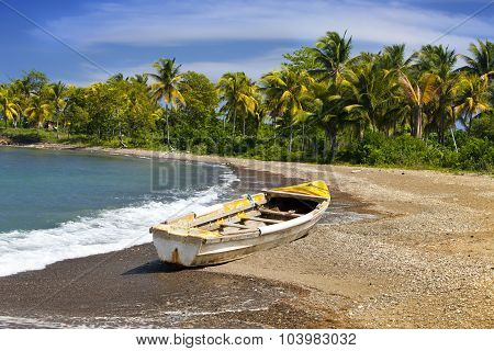 Jamaica. A national boat on sandy coast