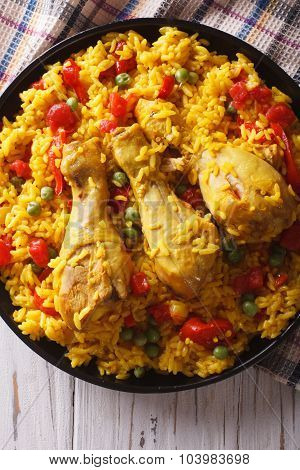 Spanish Paella With Chicken And Vegetables Closeup. Vertical Top View