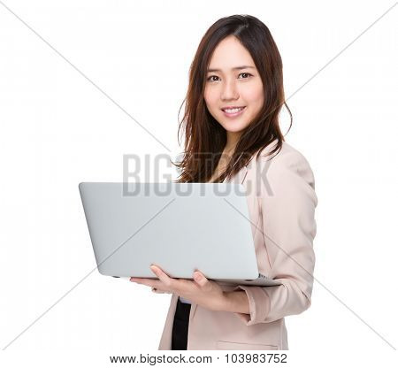 Asian businesswoman use of the notebook computer