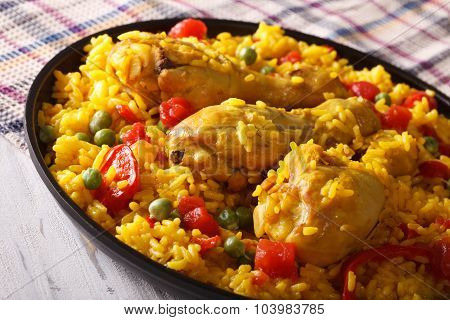 Paella With Chicken Drumsticks And Vegetables Close-up. Horizontal