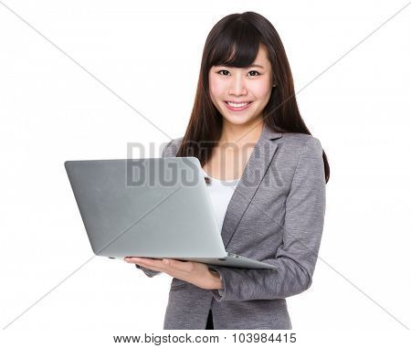 Asian Young businesswoman use of the notebook computer