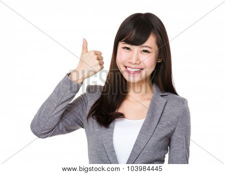 Asian Young businesswoman showing htumb up gesture