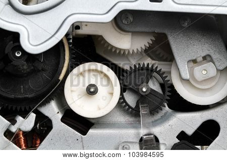 Drives and cogs in precision equipment.