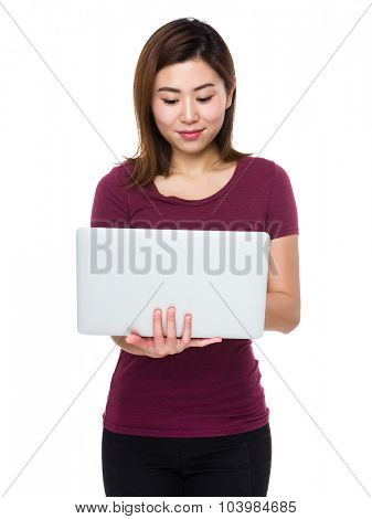 Young woman use of the laptop computer