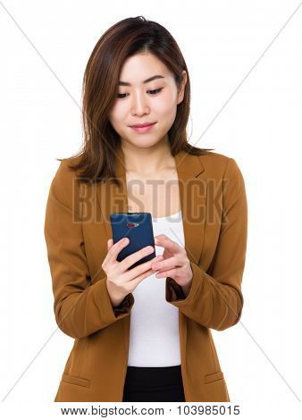 Businesswoman use of the mobile phone