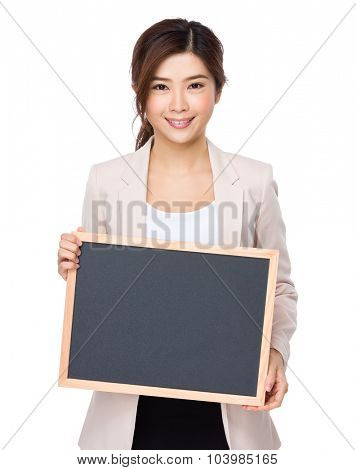 Young businesswoman show with blackboard