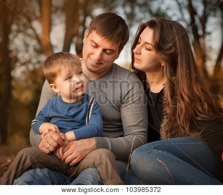 Portrait of happy family in autumn forest