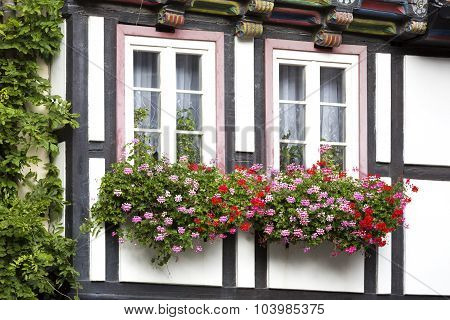 Windows of a half-timbered house in Quedlinburg town, Germany