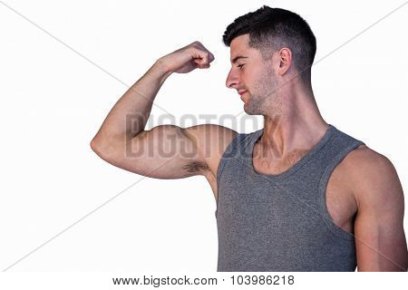 Attractive man showing biceps over white background