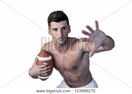 Shirtless rugby player defending over white background