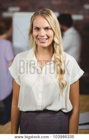 Portrait of joyful businesswoman in office