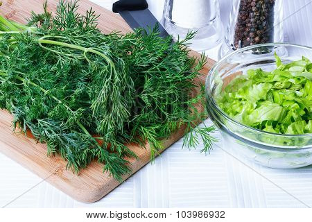 Dill On A Cutting Board