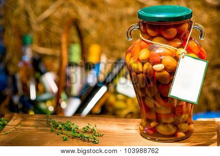 Canned Olives In Brine With Vegetables On A Cutting Board