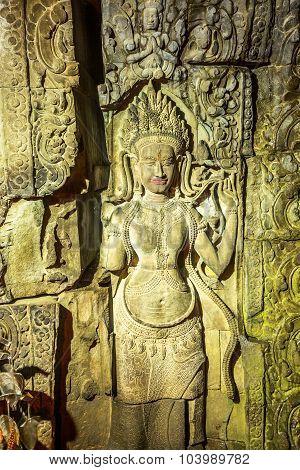 Siem Reap, Cambodia - September 17, 2015 : Beautiful ancient calving of Apsara in Preah Khan Temple during raining outside, Siem Reap, Cambodia